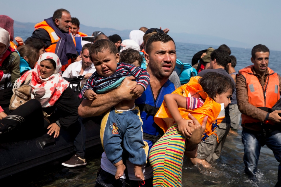 Syrian refugees arrive aboard a dinghy after crossing from Turkey to the island of Lesbos, Greece, Thursday, Sept. 10, 2015. (AP / Petros Giannakouris)