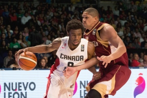Canada's Andrew Wiggins, left, controls the ball under pressure from Venezuela's Miguel Marriaga during a FIBA Americas Championship basketball game in Mexico City on Sept. 3, 2015. (Eduardo Verdugo / AP Photo)