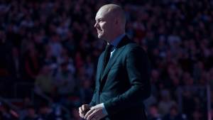 Former Toronto Maple Leafs captain Mats Sundin holds a puck as he stands on centre ice while being honoured ahead Toronto Maple Leafs and Boston Bruins NHL hockey action in Toronto on Saturday March 23, 2013. (Chris Young/THE CANADIAN PRESS)