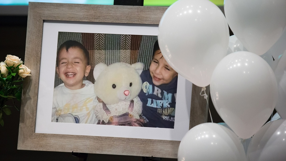 A photograph of brothers Alan and Ghalib Kurdi is displayed during a memorial service for them and their mother in Vancouver, on Saturday Sept. 5, 2015. (Darryl Dyck / THE CANADIAN PRESS)