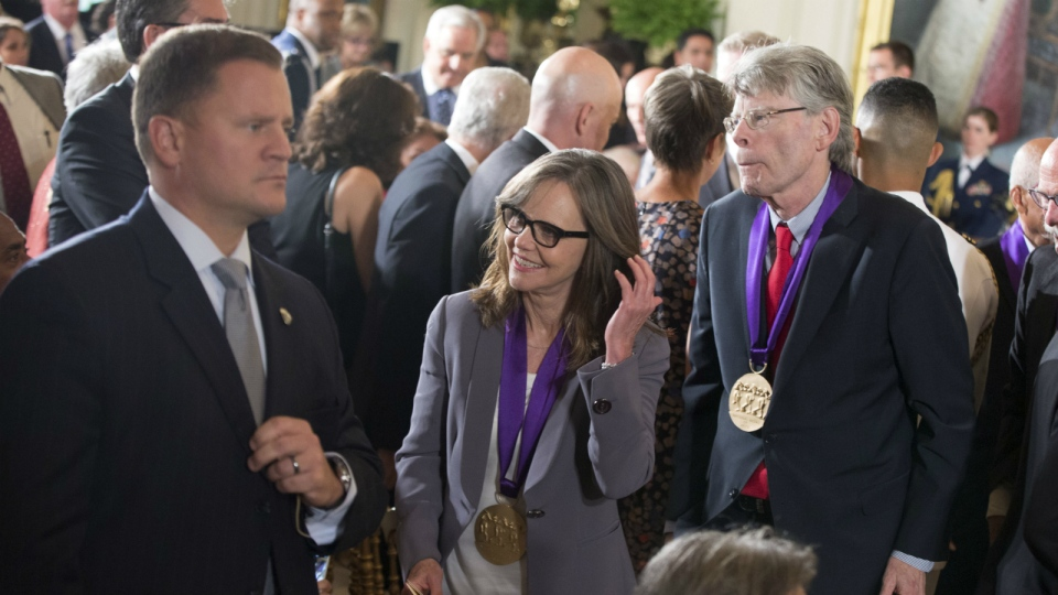 Actress and filmmaker Sally Field of Los Angles, center, and author Stephen King of Bangor, Maine, right, depart after receiving the 2014 National Medal of Arts from President Barack Obama during a ceremony in the East Room at the White House in Washington on Sept. 10, 2015. (AP / Andrew Harnik)