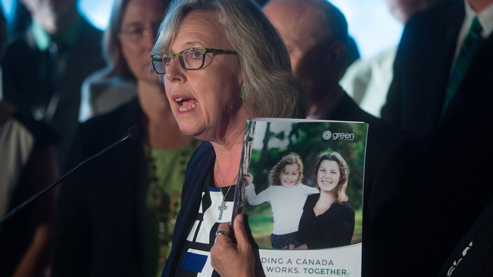 Green Party Leader Elizabeth May holds a copy of her party's platform during a campaign event in Vancouver, on Wednesday, Sept. 9, 2015. (Darryl Dyck / THE CANADIAN PRESS)