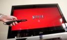 In this July 20, 2010 file photo, a person uses Netflix in Palo Alto, Calif. (AP Photo/Paul Sakuma, File)