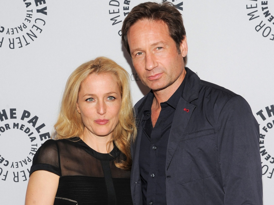 In this Oct. 12, 2013 file photo, actors Gillian Anderson and David Duchovny attend 'The Truth Is Here: David Duchovny and Gillian Anderson on The X-Files' at The Paley Center for Media, in New York. (Invision /  Evan Agostini)