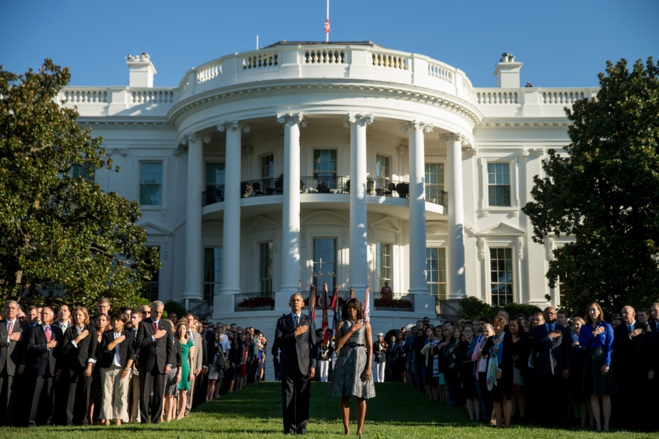 U.S. President Barack Obama, first lady Michelle Obama, and others, pause on the South Lawn of the White House in Washington, Friday, Sept. 11, 2015. (AP / Andrew Harnik)