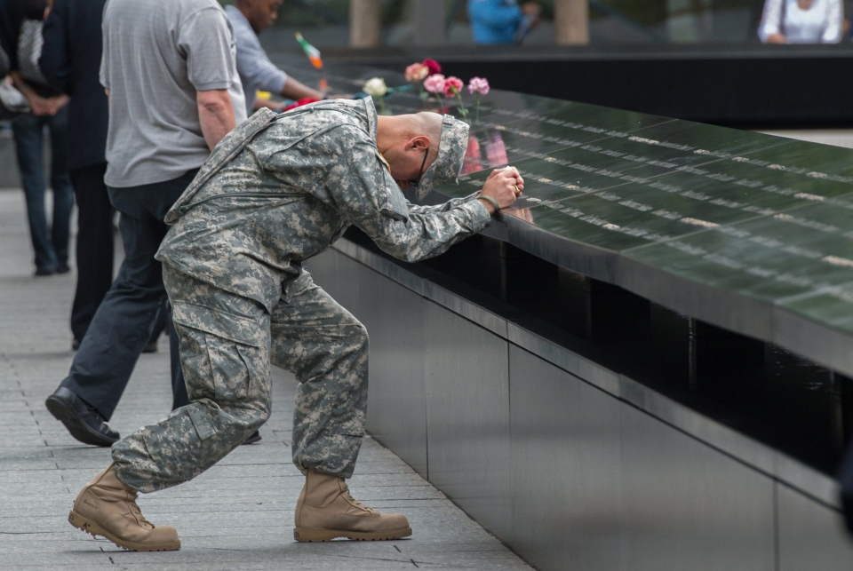 Army Sgt. Edwin Morales prays during a ceremony at the World Trade Center site in New York on Friday, Sept. 11, 2015. (AP / Bryan R. Smith)