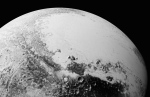 This July 14, 2015, photo provided by NASA shows a synthetic perspective view of Pluto, based on the latest high-resolution images to be downlinked from NASA's New Horizons spacecraft.