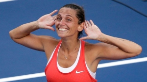 Roberta Vinci, of Italy, reacts to the crowd after beating Serena Williams during a semifinal match at the U.S. Open tennis tournament in New York, on Friday, Sept. 11, 2015. (AP Photo/Seth Wenig)