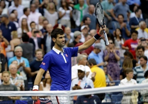 Novak Djokovic, of Serbia, waves to the crowd after beating Marin Cilic, of Croatia, during a semifinal match at the U.S. Open tennis tournament, Friday, Sept. 11, 2015, in New York. (Seth Wenig/AP Photo)
