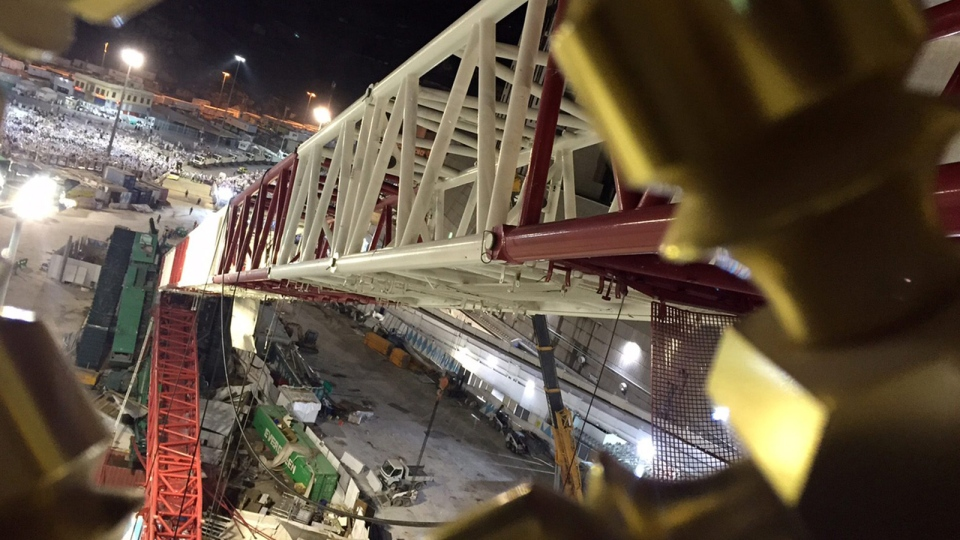 A towering construction crane is seen collapsed over the Grand Mosque, in Mecca, Saudi Arabia, early Saturday morning, Sept. 12, 2015. (AP Photo)