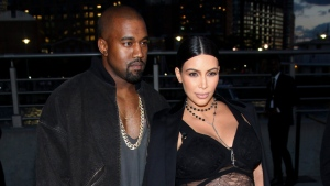 Kanye West, left, Kim Kardashian, attend the New York Fashion Week Spring/Summer 2016 Givenchy fashion show on Friday, Sept. 11, 2015, in New York. (Photo by Andy Kropa / Invision/AP)
