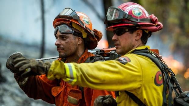 crews make gains against explosive wildfire menacing
