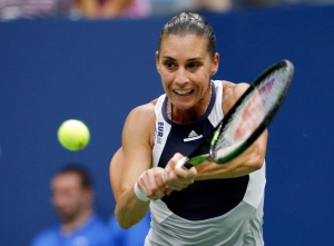 Flavia Pennetta, of Italy, returns a shot to Roberta Vinci, of Italy, during the women's championship match of the U.S. Open tennis tournament on Saturday, Sept. 12, 2015, in New York. (AP / David Goldman)