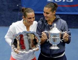 Flavia Pennetta, of Italy, right, and Roberta Vinci, of Italy, pose with their awards after Pennetta won their women's championship match of the U.S. Open tennis tournament, Saturday, Sept. 12, 2015, in New York. (AP/Seth Wenig)