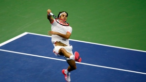 Roger Federer, of Switzerland, returns a shot to Stan Wawrinka, of Switzerland, during a semifinal match at the U.S. Open tennis tournament, Friday, Sept. 11, 2015, in New York. (AP / Julio Cortez)