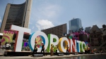 In this file photo, workers erect giant letters spelling out Toronto in Nathan Phillips Square as they prepare for the Pan Am Games, Wednesday, July 8, 2015. (AP /Rebecca Blackwell)