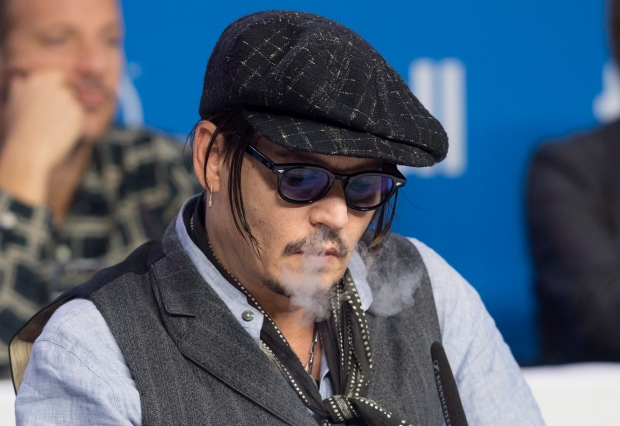 Actor Johnny Depp Exhales Vapour From An Electronic Cigarette During A Press Conference Promoting The Film Black Mass 2015 Toronto