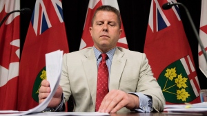 Ontario Ombudsman Andre Marin prepares to speak to reporters about the release of his annual report at Queen's Park in Toronto on Tuesday, July 28, 2015. (Darren Calabrese / THE CANADIAN PRESS)