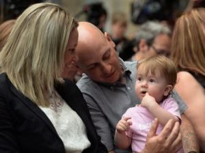 Victoria, is seen with her mother Melissa McMahon and father Simon Boisclair, of Trois-Rivieres, Que., in Ottawa on Monday, May 25, 2015, during an announcement to launch a Facebook Amber Alert System in Canada. (Sean Kilpatrick/THE CANADIAN PRESS)