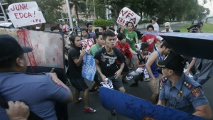 Riot police clash with protesters as the latter managed to get closer to the U.S. Embassy for a rally to mark the 24th year anniversary of the termination of the U.S. military bases in the country in Manila, Philippines on Sept. 16, 2015. (AP / Bullit Marquez)