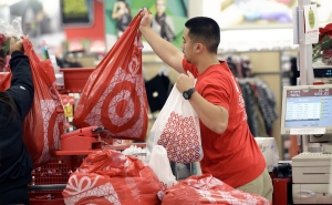 In this Nov. 23, 2012 file photo, a Target employee hands bags to a customer at the register at a Target store in Colma, Calif. (AP / Jeff Chiu)