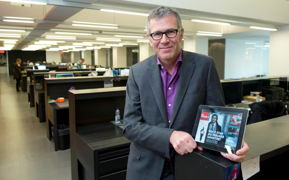 In this Wednesday, April 17, 2013 file photo, Guy Crevier, president and publisher of La Presse, is seen in the new digital newsroom in Montreal. (Paul Chiasson / THE CANADIAN PRESS)