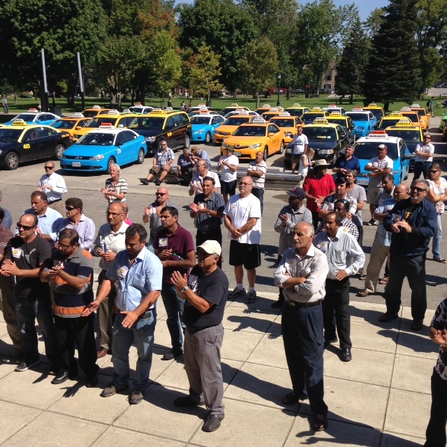 Taxi drivers attend a rally against Uber in London, Ont., on Wednesday, Sept. 16, 2015. (Bryan Bicknell / CTV Windsor)