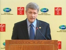 Prime Minister Stephen Harper speaks at his closing news conference at the Asia-Pacific Economic Cooperation summit in Lima, Peru, on Sunday, Nov. 23, 2008.