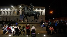 Chileans react to an earthquake in Santiago