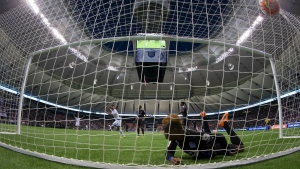 Vancouver Whitecaps' Kianz Froese, back left, celebrates his goal as C.D. Olimpia's Kevin Alvarez, front, looks on from the back of the net after failing to stop the ball behind goalkeeper Noel Valladares during the first half of a CONCACAF Champions League soccer game in Vancouver, B.C., on Sept. 16, 2015. (Darryl Dyck / THE CANADIAN PRESS)