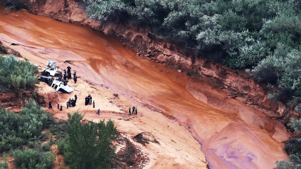 In this aerial photo community members visit the spot of the wrecked vehicles after a flash flood in Zion National Park, Utah on Sept. 16, 2015. (Scott G Winterton / The Deseret News)