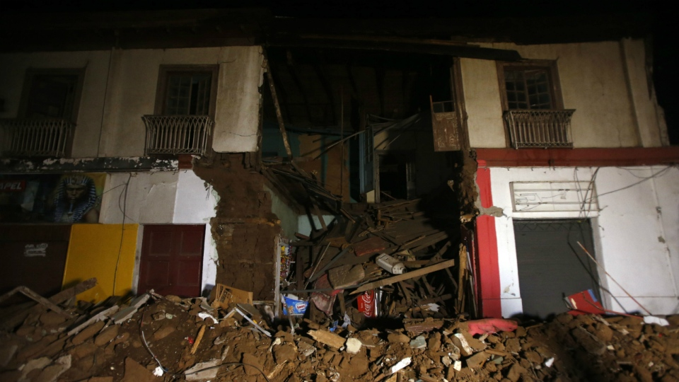 Debris of a destroyed house sit on a street in Illapel, Chile on Sept. 17, 2015. (AP / Luis Hidalgo)
