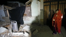 Resident surveys destroyed home in Chile