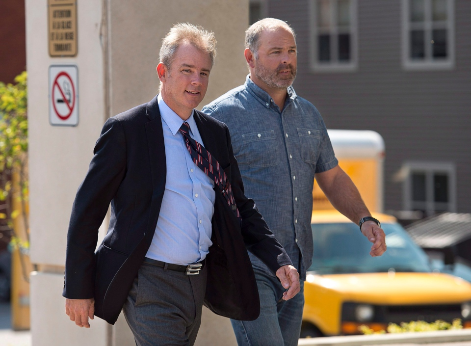 Dennis Oland walks with an unidentified friend at his trial in Saint John, N.B. on Wednesday, Sept. 16, 2015. (Andrew Vaughan / THE CANADIAN PRESS)