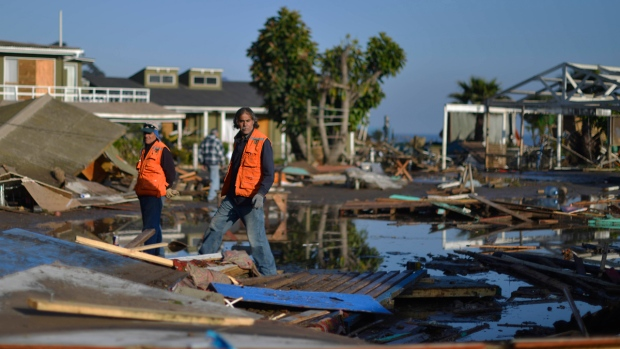 People survey damage near the beach after an earthquake-triggered tsunami in Concon, Chile, Thursday, Sept. 17, 2015. (AP / Matias Delacroix)