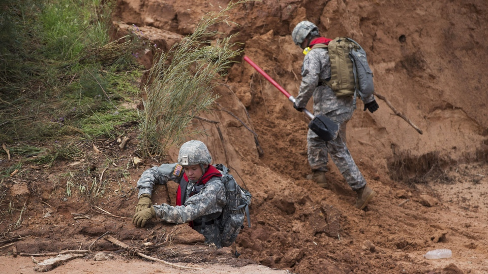 Utah National Guardsmen climb out of Short Creek while searching for a missing person in Colorado City, Ariz. Wednesday, Sept. 16, 2015. (Michael Chow / The Arizona Republic)