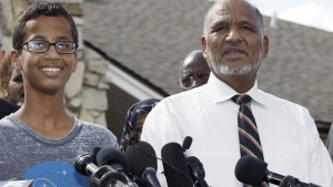 Ahmed Mohamed, 14, left, and his father, Mohamed Elhassan Mohamed, thank supporters during a news conference at their home in Irving, Texas, on Wednesday, Sept. 16, 2015. (AP / Brandon Wade)