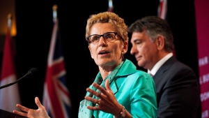 Ontario Premier Kathleen Wynne and Finance Minister Charles Sousa are shown in Toronto on Tuesday June 11, 2013. (Aaron Vincent Elkaim / THE CANADIAN PRESS)