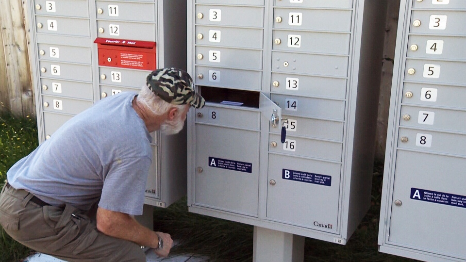 Montreal resident Peter Perron says Canada Post's new community mailboxes are too narrow and he can't reach his mail.
