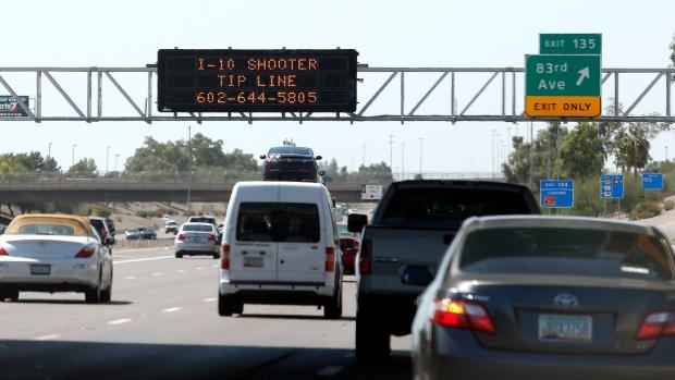A sign still displays a shooter tip line above Interstate 10 in Phoenix on Sept. 10, 2015. (AP / Ross D. Franklin)