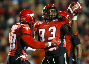 Calgary Stampeders' Micah Johnson, right, celebrates recovering a fumbled B.C. Lions football during second half CFL football action in Calgary on Friday, Sept. 18, 2015. (THE CANADIAN PRESS / Jeff McIntosh)