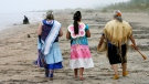 In this 2009 file photo, three women walk on Ipperwash beach near Forest, Ont. (THE CANADIAN PRESS/Dave Chidley)