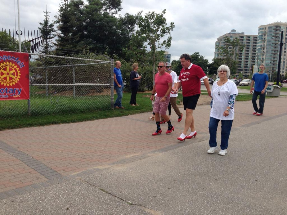 Participants of the Barrie, Ont. Walk a Mile in Her Shoes event wobble along on Saturday, Sept. 19, 2015. (Brandon Rowe/ CTV Barrie)