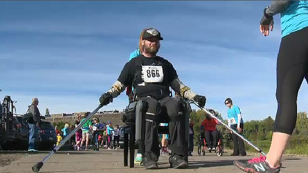 Denny Ross participates in annual N.E.R.D Run using ReWalk exoskeleton Saturday, September 19, 2015 in Hawrelak Park.