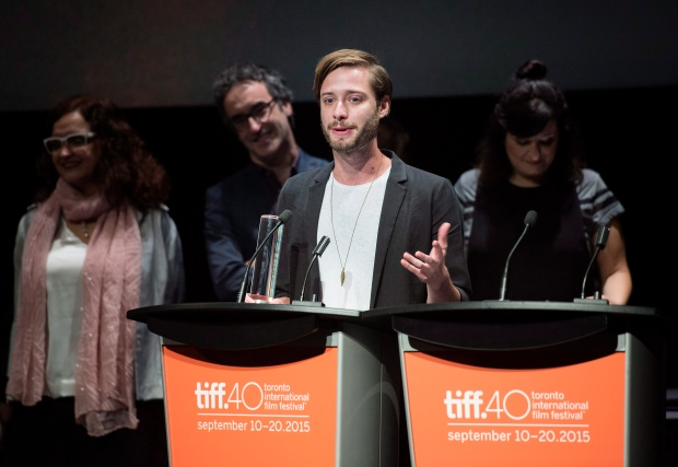 Director Stephen Dunn accepts the award for Best Canadian Feature for the film 'Closet Monster' during the 2015 Toronto International Film Festival Awards on Sunday, Sept. 20, 2015. (Darren Calabrese / THE CANADIAN PRESS)