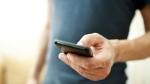 A man dials a cellphone. (Kostenko Maxim / shutterstock.com)