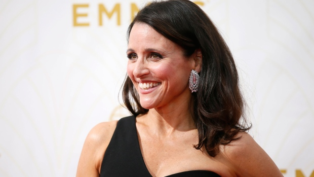 Julia Louis-Dreyfus arrives at the 67th Primetime Emmy Awards on Sunday, Sept. 20, 2015, at the Microsoft Theater in Los Angeles. (Danny Moloshok / Invision for the Television Academy)
