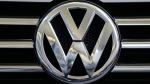 A Volkswagen logo is seen on the grill of a Volkswagen on display in Pittsburgh, Feb. 14, 2013. (AP / Gene J. Puskar)