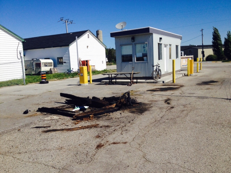 The remains of a fire that left Pierre George seriously injured are seen at the gates of Camp Ipperwash, Ont. on Monday, Sept. 21, 2015. (Sean Irvine / CTV London)