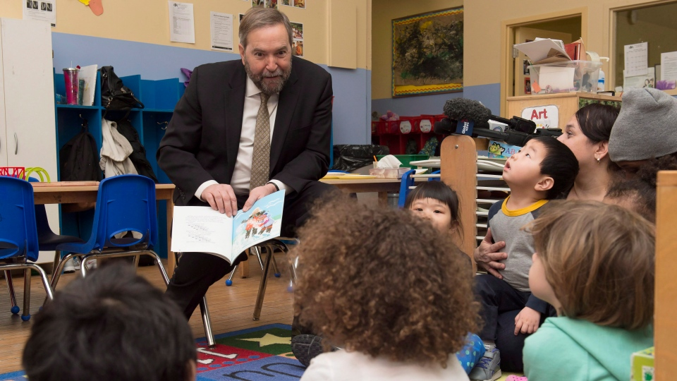 NDP Leader Tom Mulcair reads to children in Toronto, on Tuesday, Jan. 20, 2015. (Frank Gunn / THE CANADIAN PRESS)